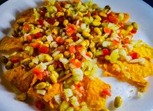 Spicy mixture of peanut tomato onion nacho cucumber royalty free stock photos