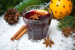 Spicy mulled wine in the glass in the snow Stock Photography