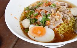 Spicy noodle with slice boiled pork and topping boiled egg Stock Image