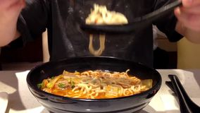 Spicy noodle soup stock video footage