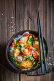 Spicy noodle with vegetables, chicken and chili peppers Stock Image