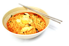 Spicy noodles. With egg and chopstick Royalty Free Stock Image