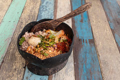 spicy noodles in coconut shell on wood table asia food Stock Photography
