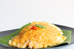Spicy omelet  on banana leaf. In black dish Royalty Free Stock Photos