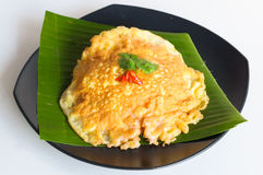 Spicy omelet  on banana leaf. In black dish Royalty Free Stock Images