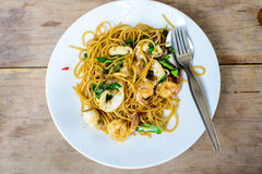 Spicy paghetti with seafood on wood Stock Photography