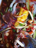 spicy papaya and corn salad with black crab Thailand  called farmer crab and fresh shrimp stock photography