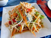 Spicy papaya salad with blue crab or Somtum in Thai language. Serving on the table Royalty Free Stock Image
