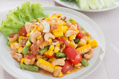 Spicy papaya salad with corn. For food background stock image