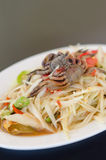 Spicy papaya salad with crab. On dish , asian spicy food stock photo