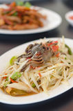 Spicy papaya salad with crab. On dish , asian spicy food stock image