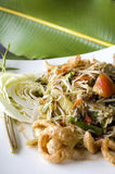 Spicy papaya salad on green. Spicy papaya salad plate on green background Royalty Free Stock Images