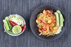 "Spicy papaya salad with mixed vegetable call ""Som Tum J"" is organic food served. Vegetable festival ,spicy papaya salad as lentils,cucumber,cashew Royalty Free Stock Image"