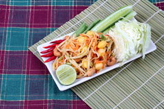 "Spicy papaya salad with mixed vegetable call ""Som Tum J"" is organic food served. Vegetable festival ,spicy papaya salad as lentils,cucumber,cashew Stock Images"