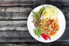 Spicy papaya salad with mixed vegetable  for Chinese vegetable f. Chinese Vegetable festival as spicy papaya salad with mixed vegetable call Som Tum J in Thai Royalty Free Stock Photos