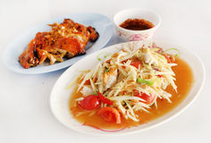 Spicy papaya salad and roasting chicken Stock Photography