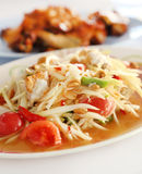 Spicy papaya salad and roasting chicken Royalty Free Stock Photo