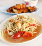 Spicy papaya salad and roasting chicken Royalty Free Stock Image