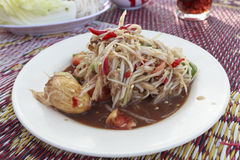 Spicy papaya salad with salted. Crab and fermented fish stock photos