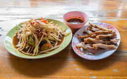 Spicy papaya salad with salted crab and fermented fish and grill Stock Images