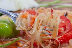 Spicy papaya salad or Som Tum in Thailand. With fork stock image