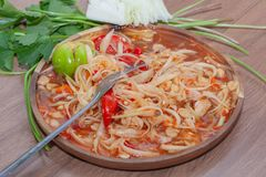 Spicy papaya salad or Som Tum in Thailand. With fork royalty free stock photography