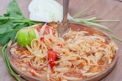Spicy papaya salad or Som Tum in Thailand. With fork stock photo