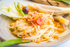 Spicy papaya salad Som tum. With vegetable - Thai food style , Color Filter Processing stock photography