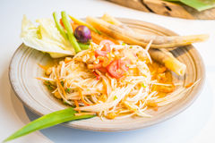 Spicy papaya salad Som tum. With vegetable - Thai food style , Color Filter Processing stock photos