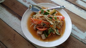Thai favourite traditional dish spicy papaya salad Somtam. Spicy papaya salad Sontam.  Undeniably tasty. Easy to make andcan be enjoy all year round It is Royalty Free Stock Photos