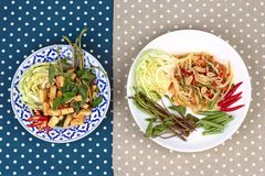 Spicy papaya salad and Spicy sour mixed herb salad with fried to Stock Photo