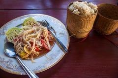 Spicy papaya salad. With sticky rice, Laos stock image