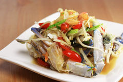 Spicy papaya salad with swimming blue crab. Somtum thai-style Royalty Free Stock Photography
