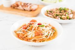 Spicy papaya salad (Traditional Thai food). On the table Royalty Free Stock Photo