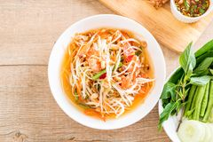 Spicy papaya salad (Traditional Thai food). On the table Royalty Free Stock Photos