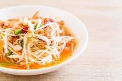 Spicy papaya salad (Traditional Thai food). On the table Stock Photos