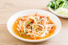 Spicy papaya salad (Traditional Thai food). On the table Stock Photo