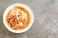 Spicy papaya salad (Traditional Thai food). On the table Royalty Free Stock Images