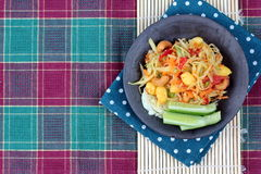 Spicy papaya salad with vegetable. Vegetable festival ,spicy papaya salad as lentils,cucumber,cashew nuts,ginkgo,tomato,red chili and green lemon with mixed royalty free stock photos