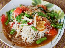 Spicy papaya salad with Vegetable and Rice noodle Stock Image