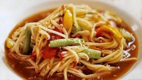 SPICY PAPAYA SALAD ON WHITE DISH. Spicy papaya salad white dish street food market chili grean mixed thai tomato popular vegetable eating meal sale stock images
