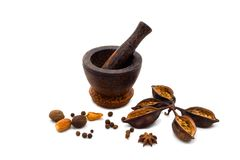 Spicy (papper, nutmeg, cloves) with mortar Stock Photos