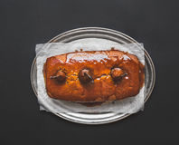 Spicy pear cake with caramel topping on a silver dish on dark su Royalty Free Stock Photo