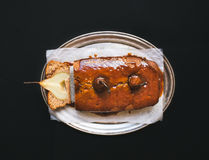 Spicy pear cake with caramel topping on a silver dish over a dark Royalty Free Stock Photo