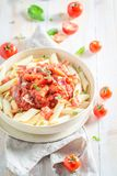 Spicy penne bolognese made of fresh tomatoes Royalty Free Stock Images