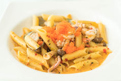 Spicy penne seafood Stock Photo