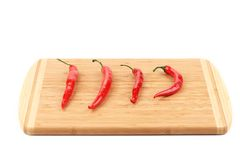 Spicy pepper on cutting board. Stock Photography