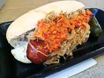 Spicy pepper giant pork German hot dog with special mustard sauc Royalty Free Stock Photography