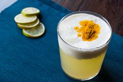 Spicy Pisco Sour Cocktail made with Lime juice, Egg White and Peruvian Grape Schnaps. Beverage Concept Royalty Free Stock Photos