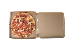 Spicy pizza on carboard box Royalty Free Stock Image